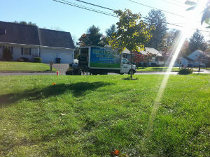 This Is A Photo Of A New England Lawn Care Truck At A Residence Doing A Fertilization