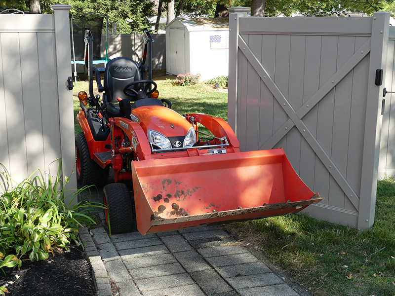 Tractor Working On Lawn Aeration And Seeding, Lawn Renovation, Massachusetts, Connecticut